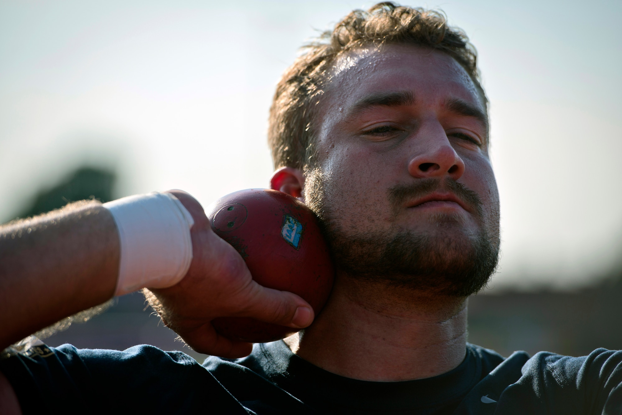 Retired Navy  Petty Officer 3rd Class Max Rohn prepares to toss a shot put during training for the inaugural 2014 Invictus Games Sept. 8, 2014, at Mayesbrook Field in London. The international paralympic-style, multi-sport event is designed for wounded service members. (U.S. Air Force photo/Staff Sgt. Andrew Lee)
