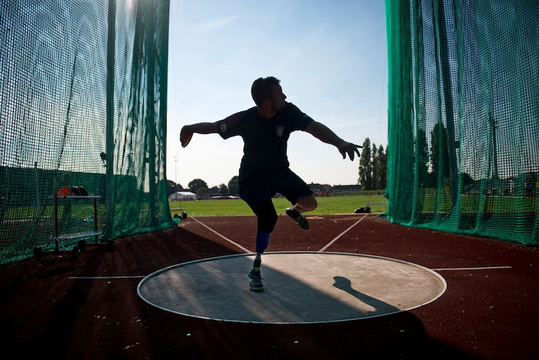 Max Rohn, a retired U.S. Navy Petty Officer 3rd Class, winds up to throw a discus during training for the inaugural 2014 Invictus Games at Mayesbrook Field Sept. 8, 2014, in London. The Invictus Games is an international Paralympic-style, multi-sport event designed for wounded service members. (U.S. Air Force photo/Staff Sgt. Andrew Lee)
