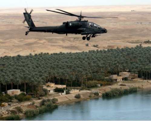 "An AH-64A Apache helicopter of the 1-149th Attack-Reconnaissance Battalion, Texas Army National Guard, conducts a ""VIP"" escort mission along the Euphrates River in Iraq on Thanksgiving Day 2006 during the unit's deployment in support of Operation Iraqi Freedom."