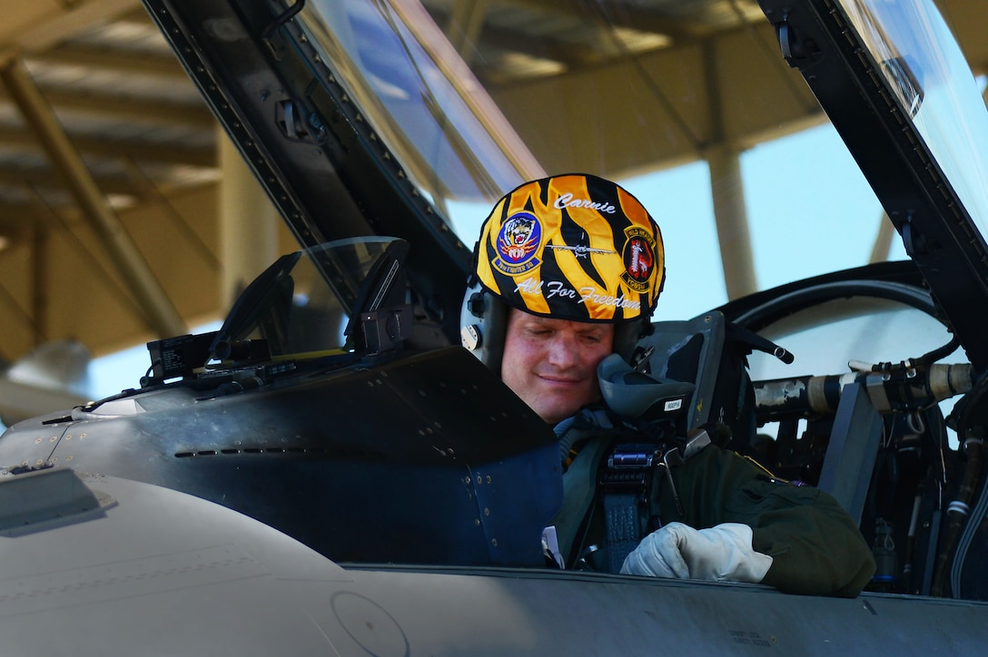 Royal Air Force Flight Lieutenant Benjamin Cable sits in the cockpit of an F-16CM Fighting Falcon Aug. 27, 2014, at Shaw Air Force Base, S.C. Cable will be stationed at Shaw for three years, where he will learn from and teach members of the 79th FS. Cable is a 79th Fighter Squadron assistant director of operations. (U.S. Air Force photo/Airman 1st Class Michael Cossaboom)