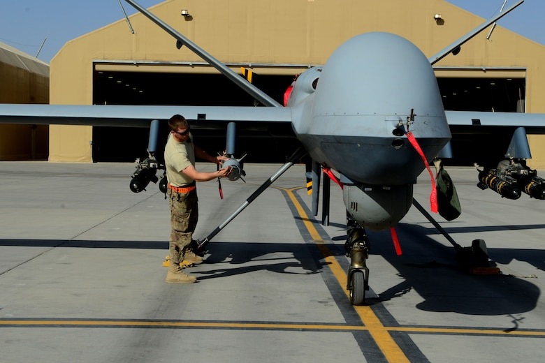 Staff Sgt. Nelson Cherry inspects an MQ-9 Reaper with the 62nd Expeditionary Reconnaissance Squadron Aug. 18, 2014, at Kandahar Airfield, Afghanistan. The Reaper is launched, recovered and maintained here. It is also remotely operated by pilots in bases located in the U.S. Cherry is an aircraft armament systems specialist with the 451st Expeditionary Aircraft Maintenance Squadron. (U.S. Air Force photo/Staff Sgt. Evelyn Chavez)