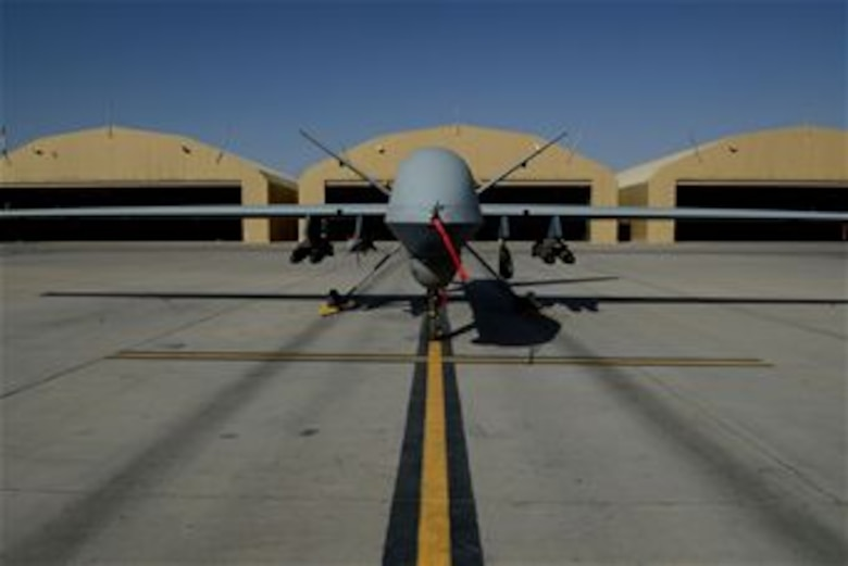 An MQ-9 Reaper with the 62nd Expeditionary Reconnaissance Squadron sits on a ramp Aug. 18, 2014, at Kandahar Airfield, Afghanistan. The Reaper is launched, recovered and maintained here. It is remotely piloted by pilots in bases located in the U.S. (U.S. Air Force photo/Staff Sgt. Evelyn Chavez)
