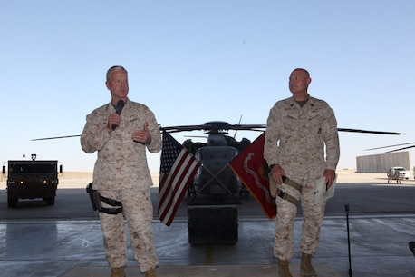 General James F. Amos, left, the 35th Commandant of the Marine Corps, and Sgt. Maj. Micheal Barrett, the 17th Sergeant Major of the Marine Corps, speak to Marines and sailors of Marine Aircraft Group - Afghanistan aboard Camp Bastion, Afghanistan, Sept. 6, 2014. Gen. Amos and Sgt. Maj. Barrett visited Marines and sailors serving with Marine Expeditionary Brigade – Afghanistan in Helmand province for the final time, thanking them for their service and sacrifice.