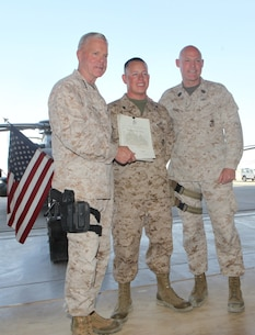 Corporal Matthew Padilla, center, an airframe mechanic with Marine Aviation Logistics Squadron 17, Marine Aircraft Group – Afghanistan, gets his photo taken with Gen. James F. Amos, right, the 35th Commandant of the Marine Corps, and Sgt. Maj. Micheal Barrett, the 17th Sergeant Major of the Marine Corps, following his meritorious promotion ceremony aboard Camp Bastion, Afghanistan, Sept. 6, 2014. Gen. Amos meritoriously promoted Padilla, a native of Littleton, Colo., to the rank of corporal during his final visit to Helmand province.