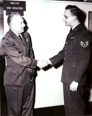Lynwood G. Landbeck, former Air Force Staff Sgt., shakes hands with a colonel at his separation ceremony in 1955 at Wright-Patterson Air Force Base, Ohio.  The Air Force color guard from Goodfellow Air Force Base provided honors at his interment Sept. 8. (Courtesy photo)