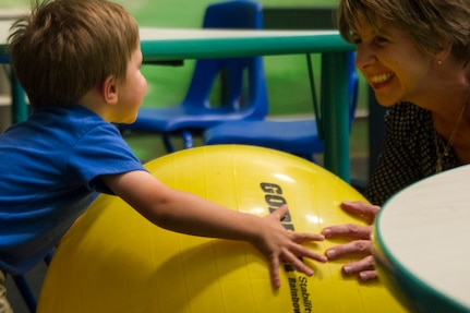 Jill Hoagland, wife of Col. Brad Hoagland, 11th Wing/Joint Base Andrews commander, plays with their son at the Parent-Child Area in the West Fitness Center here, Sept. 5, 2014. The PCA allows parents with children 6 years old and younger to access the facility. (U.S. Air Force photo/Airman 1st Class Ryan J. Sonnier)