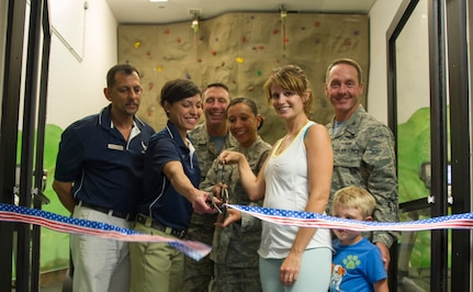 Team Andrews members welcome a new Parent-Child Area at the West Fitness Center during a ribbon cutting ceremony here, Sept. 5, 2014. The PCA allows parents with children 6 years old and younger to access the facility. (U.S. Air Force photo/Airman 1st Class Ryan J. Sonnier)