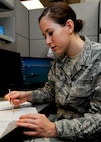 Airman 1st Class Amanda Joyce, 28th Medical Operations Squadron public health technician, separates male and female mosquitoes at Ellsworth Air Force Base, S.D., Sept. 2, 2014. Since only female mosquitoes bite and spread disease, they are collected and sent to a lab at Wright-Patterson AFB, Ohio, to be analyzed and tested. (U.S. Air Force photo by Senior Airman Anania Tekurio/Released)