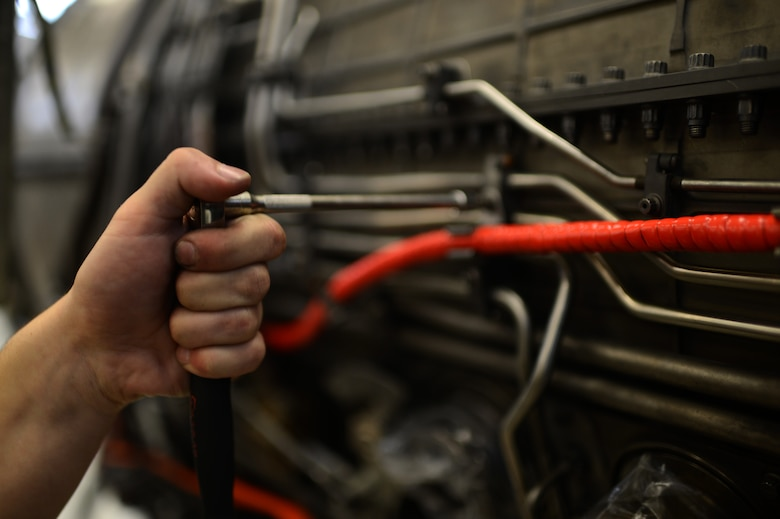 U.S. Air Force Senior Airman Trent Tubek, a 52nd Component Maintenance Squadron propulsion technician and native of Henderson, Nev., tightens a clamp on an F-16 Fighting Falcon fighter aircraft engine Sept. 9, 2014. The clamps hold tubes and cables tightly to the engine and must be updated when maintenance is performed in order to avoid mishaps. (U.S. Air Force photo by Senior Airman Gustavo Castillo/Released)