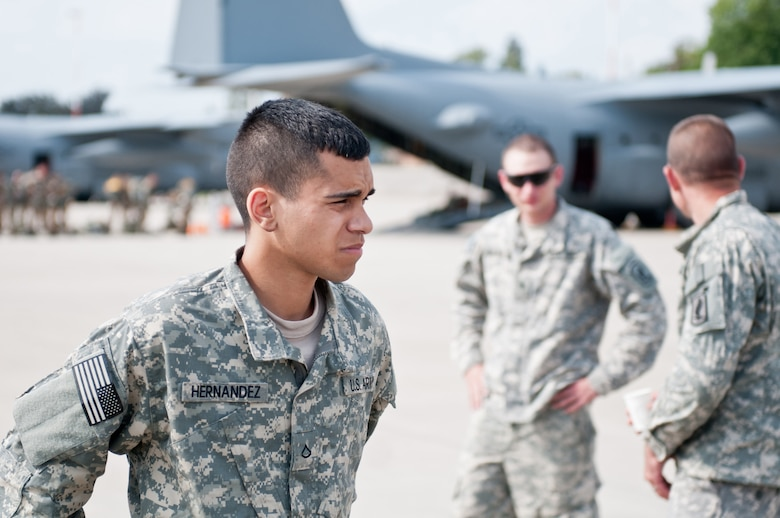 U.S. Army Pfc. Jonathon Hernandez, a paratrooper assigned to the Army's 173rd Infantry Brigade Combat Team stationed in Vicenza, Italy, collects his thoughts Sept. 5, 2014, as he prepares to board a Kentucky Air National Guard C-130 Hercules aircraft at Ramstein Air Base, Germany, in support of Operation Saber Junction. Hernandez's unit is participating in the operation with troops from 17 NATO countries. (U.S. Air National Guard photo by 2nd Lt. James W. Killen/Released)