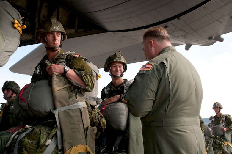 Air Force Master Sgt. Wayne Reeser (right), a loadmaster from the Kentucky Air National Guard's 123rd Airlift Wing, talks with a paratrooper from the Royal Canadian Regiment at Ramstein Air Base, Germany, just before a Kentucky C-130 Hercules aircraft transports the paratrooper and other NATO forces into the Baltic region Sept. 5, 2014, as part of Operation Sabre Junction. The Kentucky Air National Guard is participating in the operation along with five other Air National Guard Units and forces from 17 NATO countries. (U.S. Air National Guard photo by 2nd Lt. James W. Killen/Released)