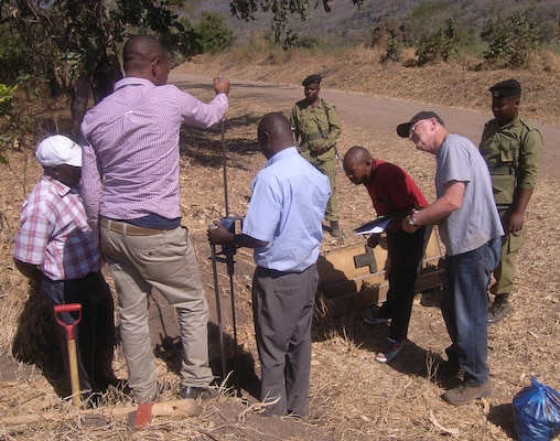 Dave Ray, chief of geotechnical sciences branch, Omaha District USACE, joins TANROADS engineers in assessing roads with a Dynamic Cone Penetrometer in Tanzania.