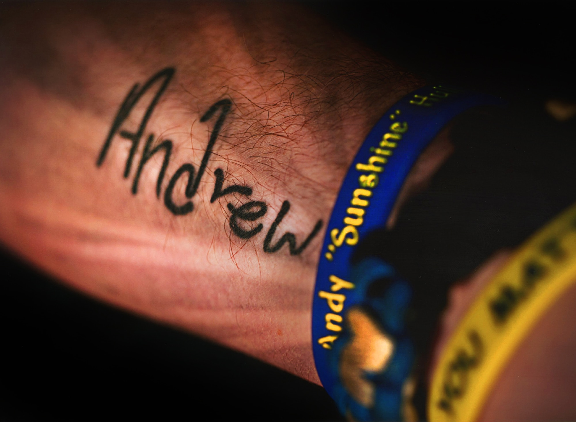 Staff Sgt. Joshua Hull displays his tattoo in memory of his younger brother, Andrew Hull. Andrew took his own life in December of 2012, when he was only 16-years-old. Since the incident, Hull has committed his time to spreading suicide awareness and prevention through the Andy Hull Sunshine Foundation. Hull is the NCO in charge of the Minot Air Force Base Honor Guard. (Courtesy photo)