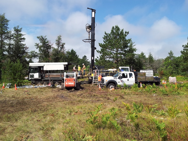 Contractors use a track-mounted rotosonic drill rig to install monitoring wells at the Raco Army Airfield and Missile Site, in the Hiawatha National Forest in Michigan as part of the ongoing environmental remedial investigation.