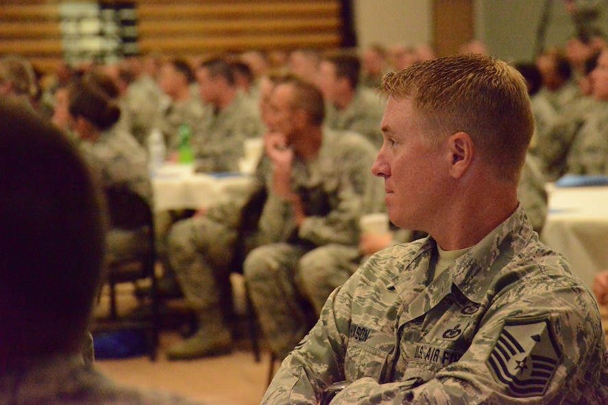 Master Sgt. Seaton Hixon of the 172nd Airlift Wing, Mississippi Air National Guard listens to presenters speak about the importance of the National Guard and professional Airmanship at the Enlisted Leadership Symposium held at Camp Dawson, W.V., Aug. 26-28, 2014. (U.S. Air National Guard photo by Senior Airman John E. Hillier)