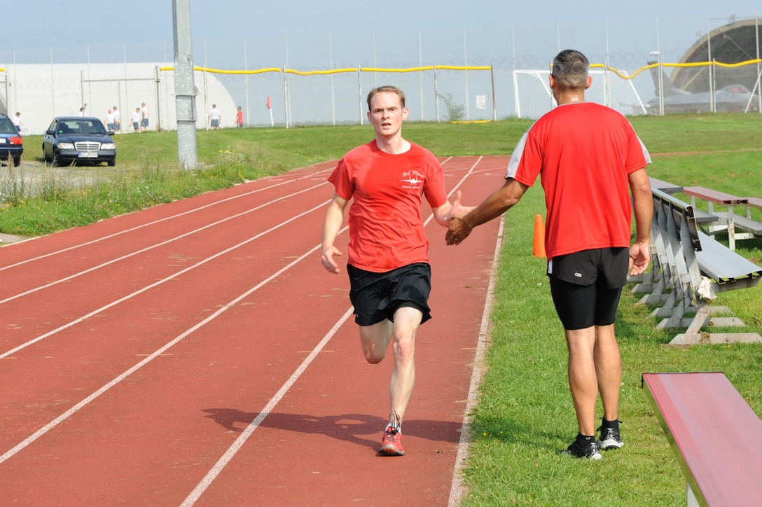 U.S. Army Sgt. 1st Class Mica Snell, 480th Fighter Squadron ground liaison officer from Wichita, Kan., right, high-fives an Airman finishing a 5K during the 2014 Combined Federal Campaign-Overseas kickoff Sept. 8, 2014, at Spangdahlem Air Base, Germany. Each unit has a CFC-O representative who can help Airmen make donations during the two-month campaign. (U.S. Air Force photo by Airman 1st Class Dylan Nuckolls/Released)