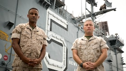 Sergeant Maj. James Roberts (left) and Gunnery Sgt. Jason M. Whipkey stand on the flight deck of the USS Peleliu (LHA-5) September 10. The Marines were embarked on the ship 13 years ago when it was diverted from Darwin, Australia to Afghanistan in response to the terror attacks on September 11, 2001. Roberts is the Sergeant Major of the 31st Marine Expeditionary Unit and is from Dallas. Whipkey is the platoon sergeant for Weapons Co., Battalion Landing Team 3rd Battalion, 5th Marines, 31st MEU and is from Carneys Point, New Jersey. The 31st MEU/Peleliu Amphibious Ready Group is currently conducting Amphibious Integration Training in preparation for the regularly schedule Fall Patrol '14. The 31st MEU is the only continuously forward-deployed expeditionary unit.