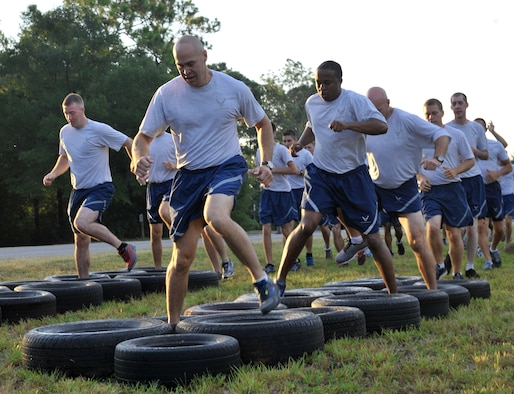556th RED HORSE Squadron Airmen, run through tires during the 2014 RED HORSE Rumble Obstacle Course, Sept. 6, 2014 at Hurlburt Field, Fla. Airmen were split into two groups during the event,  the top three teams from each group received prizes. (U.S. Air Force photo/Senior Airman Kentavist P. Brackin)
