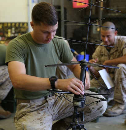 Cpl. Christopher Del Valle, field radio operator, with the communications section of the, Ground Combat Element Integrated Task Force conducts a limited technical inspection of a radio antenna at the 8th Marine Regiment communications building, Sept. 9, 2014. Marines conducted a gear check of equipment to ensure it was in working order for the GCEITF. From October 2014 to July 2015, the GCEITF will conduct individual and collective level skills training in designated ground combat arms occupational specialties in order to facilitate the standards-based assessment of the physical performance of Marines in a simulated operating environment performing specific ground combat arms tasks. (Official Marine Corps photo by Cpl. Paul S. Martinez/Released)