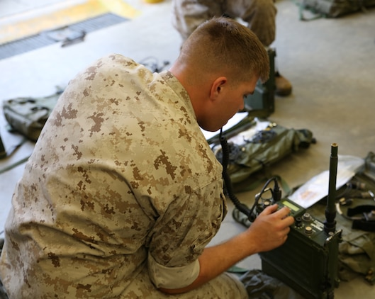 Lance Cpl. Reid Abell, field radio operator with the communications section of the Ground Combat Element Integrated Task Force, conducts a limited technical inspection of radio equipment at the 8th Marine Regiment communications building, Sept. 9, 2014. Marines conducted a gear check of equipment to ensure it was in working order for the GCEITF. From October 2014 to July 2015, the GCEITF will conduct individual and collective level skills training in designated ground combat arms occupational specialties in order to facilitate the standards-based assessment of the physical performance of Marines in a simulated operating environment performing specific ground combat arms tasks. (Official Marine Corps photo by Cpl. Paul S. Martinez/Released)