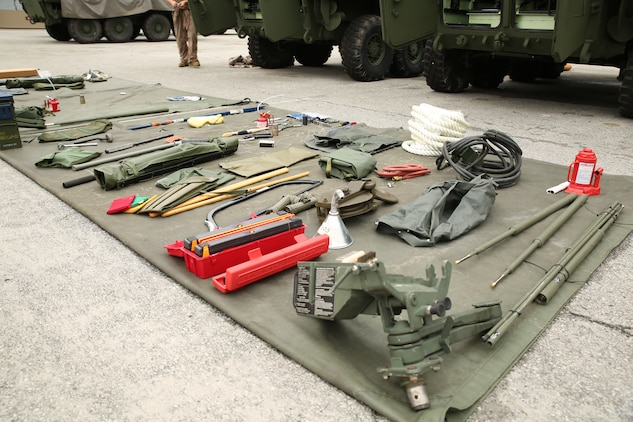 Marines with  Company B, Ground Combat Element Integrated Task Force, conducted a limited technical inspection of five light armored vehicle 25s and one LAV logistics vehicle at the 2nd Light Armored Reconnaissance Battalion ramp, Sept. 9, 2014. Each vehicle came with dozens of tools and upkeep equipment known as stock list level three equipment. From October 2014 to July 2015, the GCEITF will conduct individual and collective level skills training in designated ground combat arms occupational specialties in order to facilitate the standards-based assessment of the physical performance of Marines in a simulated operating environment performing specific ground combat arms tasks. (Official Marine Corps photo by Cpl. Paul S. Martinez/Released)