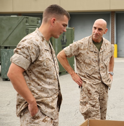 Col. Matthew G. St. Clair, right, commanding officer, Ground Combat Element Integrated Task Force, speaks with Capt. Alexander Puraty, commanding officer of Company B, GCEITF, during a limited technical inspection at the 2nd Light Armored Reconnaissance Battalion ramp, Sept. 9, 2014. The GCEITF received five LAV-25s and one LAV logistics vehicle. From October 2014 to July 2015, the GCEITF will conduct individual and collective level skills training in designated ground combat arms occupational specialties in order to facilitate the standards-based assessment of the physical performance of Marines in a simulated operating environment performing specific ground combat arms tasks. (Official Marine Corps photo by Cpl. Paul S. Martinez/Released)