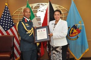 NDU Interim President Ambassador Wanda L. Nesbitt presents Major General Kenrick Maharaj of Trinidad and Tobago with a certificate confirming his induction into the International Fellows Hall of Fame on September 3, 2014.