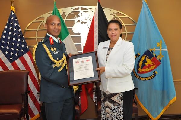 NDU Interim President Ambassador Wanda L. Nesbitt presents Major General Kenrick Maharaj of Trinidad and Tobago with a certificate confirming his induction into the International Fellows Hall of Fame on September 3, 2014.