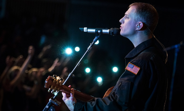 "Tech. Sgt. Clint Whitney, vocalist for U.S. Air Force Band of the Golden West rock ensemble ""Mobility,"" sings at Twin Falls High School in Twin Falls, Idaho, Sept. 9, 2014. (U.S. Air Force photo by Tech. Sgt. Samuel Morse/Released)"