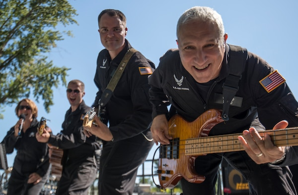 Members of Mobility look at the camera during a song at Air Force Appreciation Day in Mountain Home, Idaho, Sept. 6, 2014. Mobility is a subdivision of  the U.S. Air Force Band of the Golden West, who played numerous sets all around southern Idaho during their six day tour. (U.S. Air Force photo by Airman 1st Class Brittany A. Chase/Released)