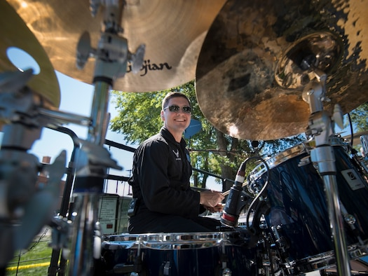 U.S. Air Force Tech. Sgt. Timothy Shaw smiles for the camera at Air Force Appreciation Day in Mountain Home, Idaho, Sept. 6, 2014. Mobility is a high-tempo rock band that travels around the western U.S. to perform for various events. (U.S. Air Force photo by Airman 1st Class Brittany A. Chase/Released)