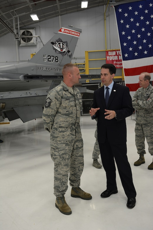 Governor Scott Walker, Wisconsin governor, takes a moment to speak with Master Sgt. Richard Carter, 115th Fighter Wing senior non-commissioned officer of the quarter, following his speech about Sept. 11, 2001, in Hangar 406 at the 115 FW in Madison, Wis., Sept. 11, 2014. Walker visited the base to thank the Airmen for serving their country and state. (Air National Guard photo by Senior Airman Andrea F. Liechti)