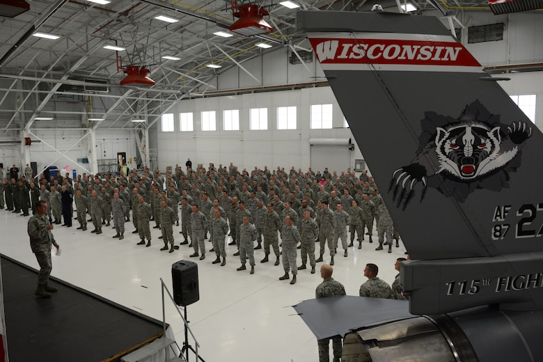 Col. Jeffrey Wiegand, 115th Fighter Wing commander, talks about the events of Sept. 11, 2001 prior to introducing Governor Scott Walker, Wisconsin governor, during a formation in Hangar 406 at the 115 FW in Madison, Wis., Sept. 11, 2014. Walker visited the base to thank the Airmen for serving their country and state. (Air National Guard photo by Senior Airman Andrea F. Liechti)