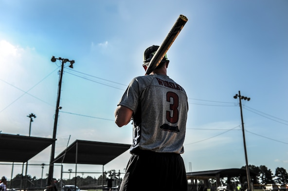 Airman 1st Class Troy Worsley, the 19th Logistics Readiness Squadron shortstop, warms up before his turn at bat during the intramural softball championship game Aug. 27, 2014 at Little Rock Air Force Base, Ark. The 19th LRS defeated the 19th Aircraft Maintenance Squadron 18-5. (U.S. Air Force photo by Airman 1st Class Cliffton Dolezal)