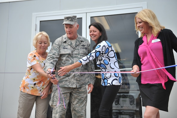 WESTHAMPTON BEACH, NEW YORK - Colonel Thomas J Owens II cuts the ribbon and officially opens the new shopette at FS Gabreski ANG on September 11, 2014.