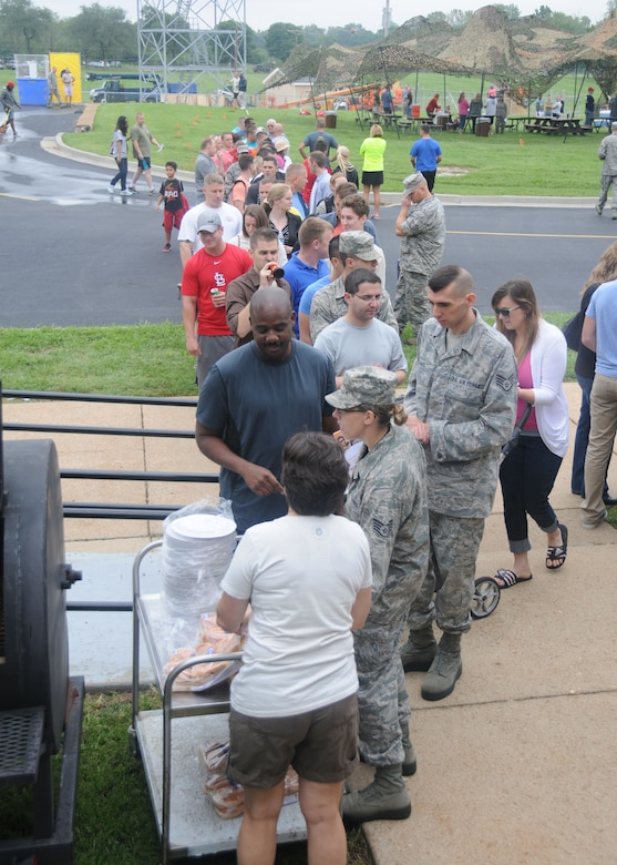 Missouri Air National Guardsmen and their Families line up to take advantage of the burgers and hot dogs grilled by the 131st Bomb Wing Chiefs Council during the Annual Jefferson Barracks Family Day event in St. Louis, Missouri on Sept. 6, 2014. (U.S. Air National Guard photo by Senior Airman Nathan Dampf)