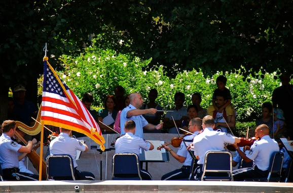 The Air Force Strings, under the direction of Captain David Alpar, performed outside the National Gallery of Art on a beautiful Sunday afternoon.  They entertained listeners of all ages with two exciting string orchestra programs. (US Air Force Photo by Senior Master Sgt. Bob Kamholz/released)