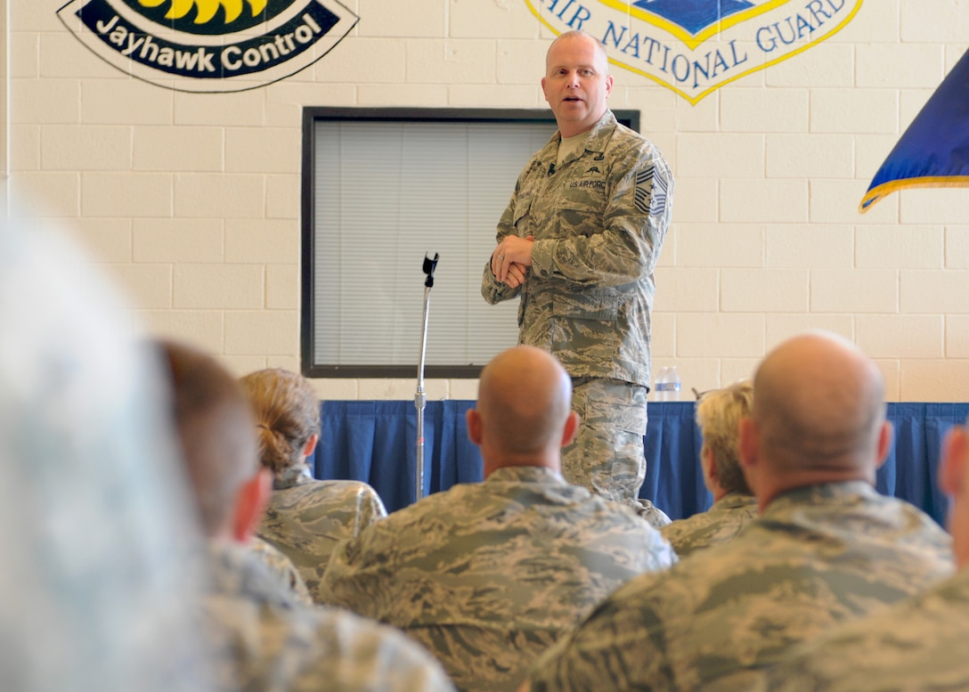 Command Chief Master Sergeant of the Air National Guard James W. Hotaling speaks to 184th Intelligence Wing enlisted members during a wing visit to McConnell AFB, Sept. 7, 2014. During the visit, Hotaling visited Airmen in their work areas and his spouse Marie Hotaling was briefed on Kansas' Family Readiness Programs and spoke with 184th volunteers and family members. (U.S. Air National Guard photo by Tech. Sgt. Maria A. Ruiz)