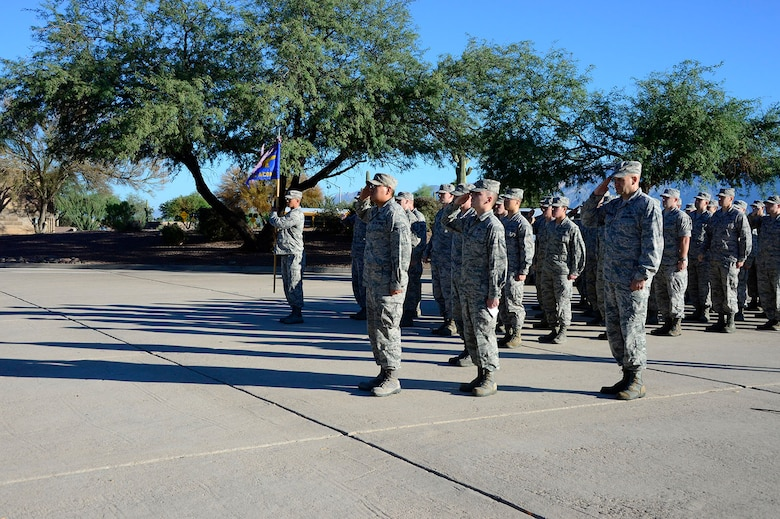 Members of the 612th Air Communications Squadron perform a final salute in remembrance of the victims of the Sept. 11, 2001 attacks at the end of their march around Davis-Monthan AFB, Ariz., Sept. 11, 2014. (USAF photo by Staff Sgt. Heather Redman/Released)