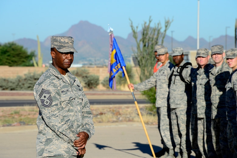 Chief Master Sgt. Calvin Williams, 12th Air Forces Southern (Command Chief), speaks with members of the 612th Air Communications Squadron at the end of their march around Davis-Monthan AFB, Ariz., in remembrance of the 9/11 victims, Sept. 11, 2014. (USAF photo by Staff Sgt. Heather Redman/Released)