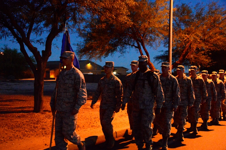 Members of the 612th Air Communication Squadron march around Davis-Monthan AFB, Ariz., in remembrance of the 9/11 victims, Sept. 11, 2014. As members marched they recalled where they were during the attacks. (USAF photo by Staff Sgt. Heather Redman/Released)