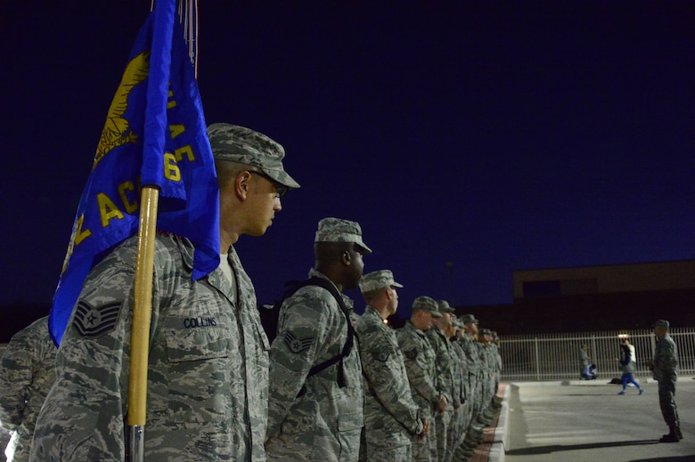 Members of the 612th Air Communication Squadron prepare to march around Davis-Monthan AFB, Ariz., in remembrance of the 9/11 victims, Sept. 11, 2014. As members marched they recalled where they were during the attacks. (USAF photo by Staff Sgt. Heather Redman/Released)