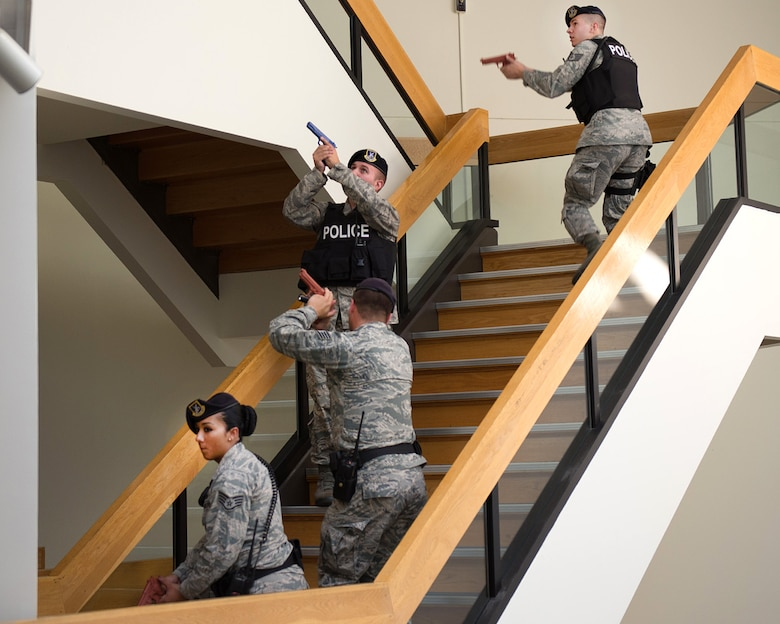 Staff Sgt. Cody Westbrook (from top to bottom), Tech. Sgt. John Twomey and Staff Sgts. Jacob White and Katherine Portes enter the lobby of the Brown Building during an active shooter exercise at Hanscom Air Force Base Sept. 5. The 66th Security Forces Squadron along with other agencies on base practiced their response to an active shooter incident as part of a base readiness exercise. (U.S. Air Force photo by Mark Herlihy)