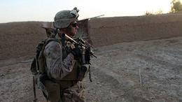 First Sgt. Brian Moody, first sergeant, Bravo Company, 1st Battalion, 2nd Marine Regiment, patrols through southern Helmand province, Afghanistan, Sept. 3, 2014. The operation was designed to deter enemy insurgents from operating in the southern area of Helmand province. (U.S. Marine Corps photo by Cpl. Cody Haas/ Released)
