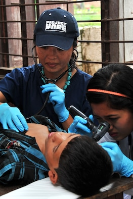 Dr. Lingie Chiu, Project Hope pediatrician, and Aanchal Shrestha, a local general medicine intern, examine a patient at a health services outreach site in Manahari, Nepal, Sept. 9, 2014, as part of Operation Pacific Angel-Nepal. PACANGEL supports U.S. Pacific Command's capacity-building efforts by partnering with other governments, non-governmental agencies and multilateral militaries in the respective region to provide medical, dental, optometry and engineering assistance to their citizens. (U.S. Air Force photo by Staff Sgt. Melissa B. White)