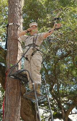 Sgt. Nathan Phelps, telephone technician, Base Telephone Office, Marine Corps Logistics Base Albany, sights in on a 3-D target while practicing with his bow, recently. MCLBAlbany deer bow-hunting season begins Saturday.