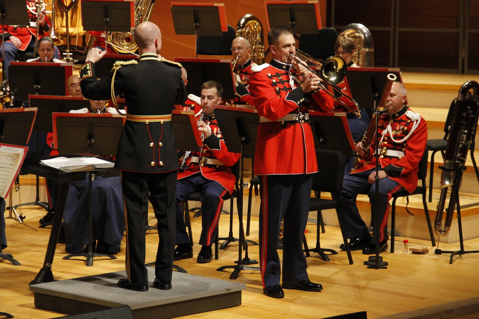 """Lieutenant Col. Jason K. Fettig, the United States Marine Band director, conducts the Marine Band while Gunnery Sgt. Samuel Barlow, a Marine Band trombonist, performs the solo portion of composer Arthur Pryor's """"Fantastic Polka"""" in Helzberg Hall at the Kauffman Center for the Performing Arts in Kansas City, Mo., as part of its 2014 National Tour. The Marine Band, also known as the """"President's Own"""", is the oldest military band in the nation and the oldest professional musical organization in the country. The Marine Band performs at state funerals, presidential inaugurations, various sporting events, and other significant national events."""