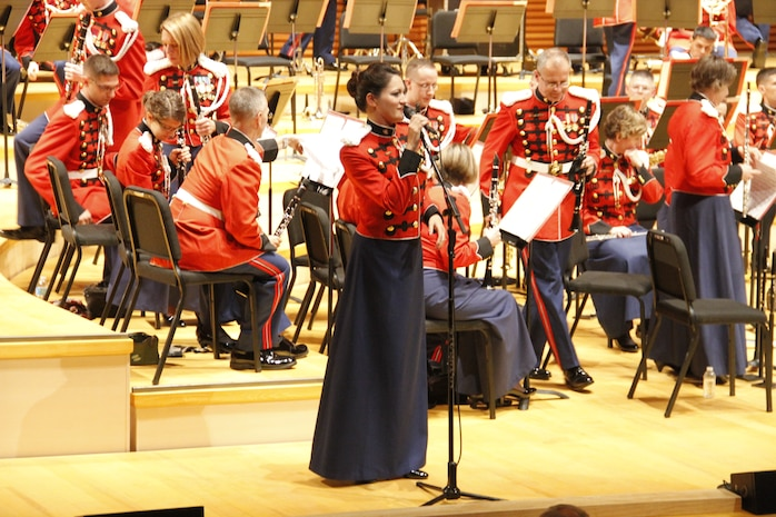 """Gunnery Sgt. Sara Dell'Omo, a United States Marine Band mezzo-soprano vocalist, addresses those in attendance in Helzberg Hall at the Kauffman Center for the Performing Arts in Kansas City, Mo., during the The President's Own's 2014 National Tour Sept. 10, 2014. The band performed a number of songs from both traiditonal and military styled compositions throughout the performance such as John Philip Sousa's """"Semper Fidelis"""", """"The Stars and Stripes Forever,"""" and """"Solid Men to the Front""""."""
