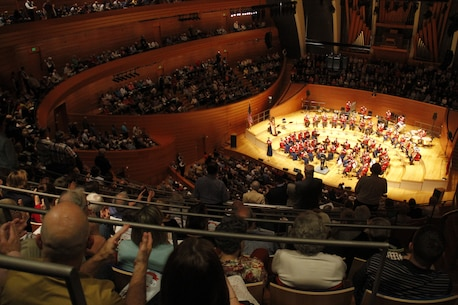 Audience members clap and stand as the United States Marine Band performs the official songs of all the United States armed forces to close out the evening's events in Helzberg Hall at the Kauffman Center for the Performing Arts in Kansas City, Mo., Sept. 10, 2014.