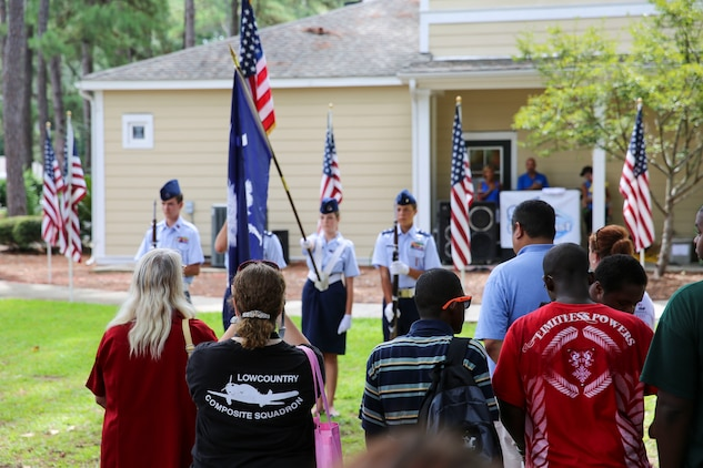 Community members watch as the Lowcountry Composite Squadron of Civil Air Patrol present the colors at a military appreciation event aboard Laurel Bay, Sept. 6. During the event, community leaders spoke as those attending enjoyed free food, games and fellowship.